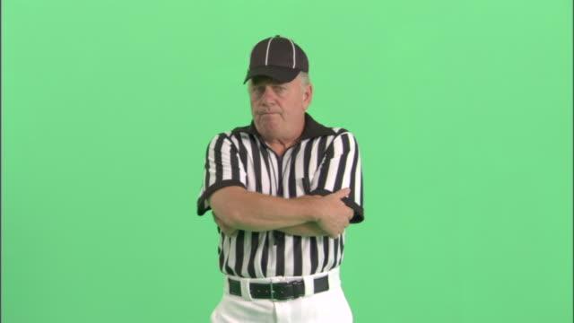 MS, Football referee standing in studio, portrait