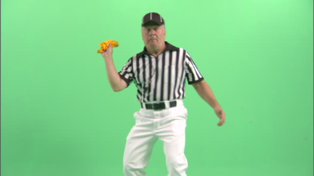 MS, Football referee throwing yellow flag in studio