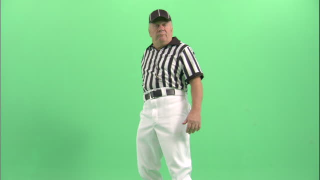ms, football referee throwing yellow flag in studio - neenah stock videos & royalty-free footage