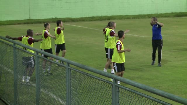 Football referees train ahead of the World Cup at Recreio in Brazil