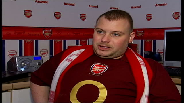 rise in ticket prices for disabled Arsenal fans ENGLAND London Jamie Brown sits in wheelchair in his bedroom Arsenal Football Club memorabilia on...