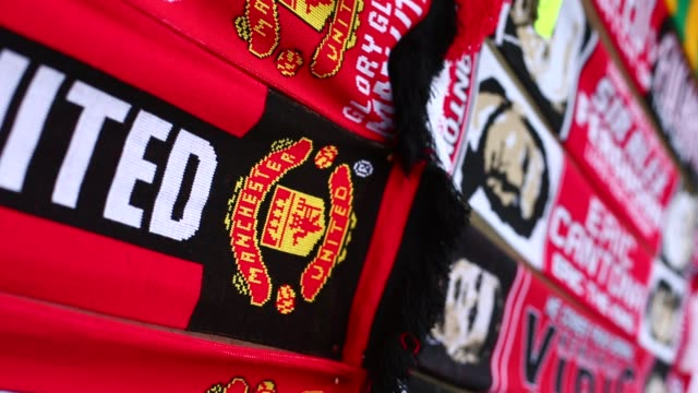 Football scarfs for sale outside Manchester United's Old Trafford Stadium in Salford north west England on January 26 Manchester United's Old...