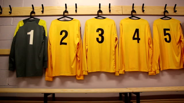 football / soccer kit hung up in changing locker room - all shirts stock videos and b-roll footage