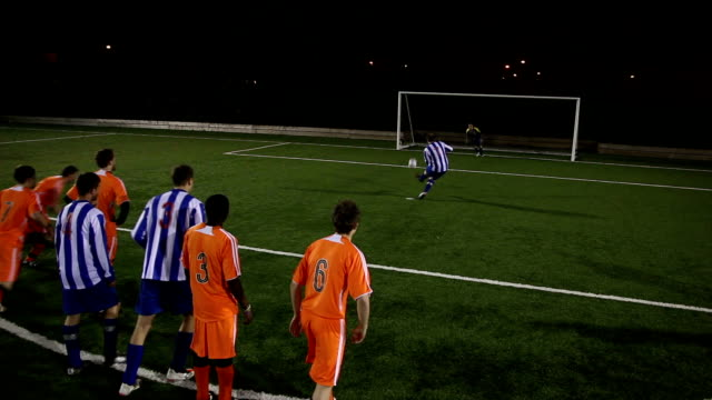 football / soccer match - striker scoring a penalty (sports) - scoring a goal stock videos and b-roll footage