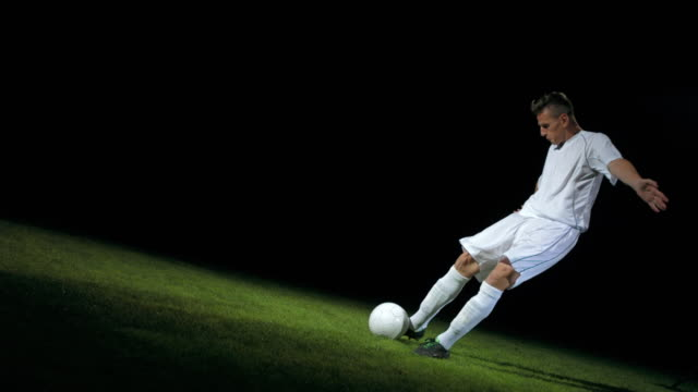 Football/ soccer player kicking the ball, timeramp