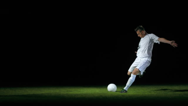 football/ soccer player kicking the ball, timeramp - hitting stock videos & royalty-free footage