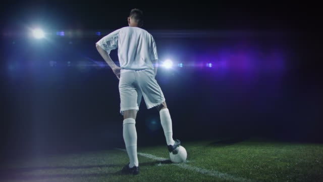 football/ soccer player posing under lights - football player stock videos & royalty-free footage