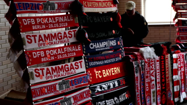 Football souvenirs are sold at the Olympiastadion subway station prior the DFB Cup final between RB Leipzig and Bayern Muenchen at Olympiastadion on...