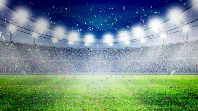 vídeos de stock e filmes b-roll de football stadium lights and confetti celebrate - football