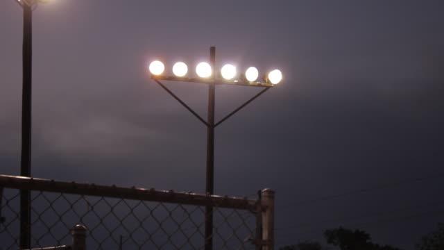 Football stadium lights, six lights on a bar attached to a pole
