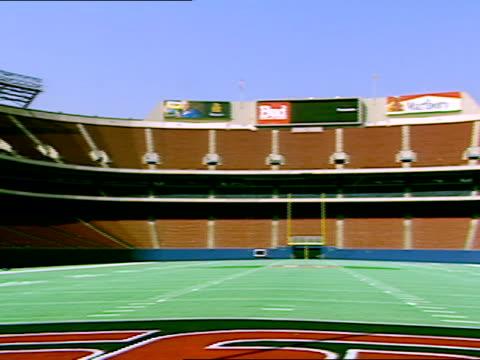 football stadium stands empty. - ゴールポスト点の映像素材/bロール