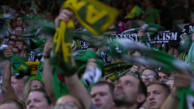 football supporters at portland timbers game in oregon holding up antifascist scarves protesting against neofascism and white supremacy - anti fascism stock videos & royalty-free footage