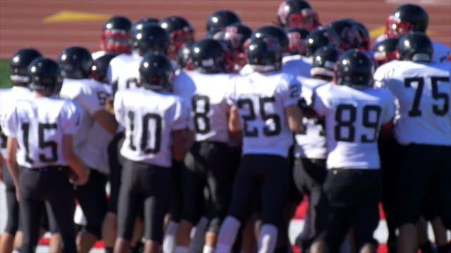 a football team huddles. - slow motion - football pitch stock videos and b-roll footage