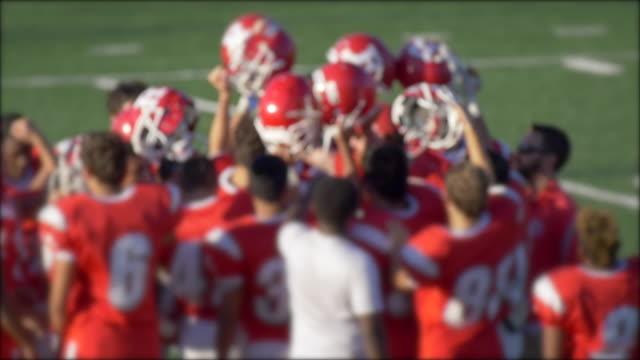 A football team huddles. - Slow Motion