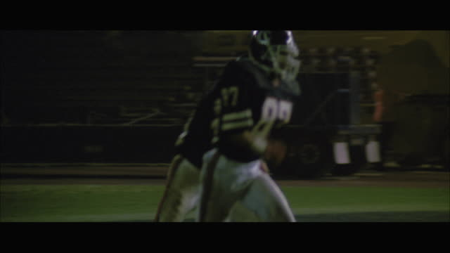 ms ts football team tackling in rain - soccer glove stock videos and b-roll footage