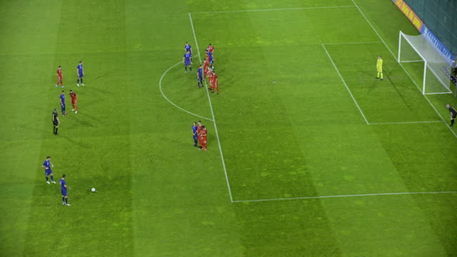 stockvideo's en b-roll-footage met football team taking an indirect free kick but the goalkeeper saves - sportwedstrijd