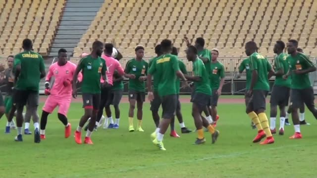 football teams from comoros and cameroon train in yaounde ahead of saturday's african cup of nations qualifying game - oranje stock videos & royalty-free footage