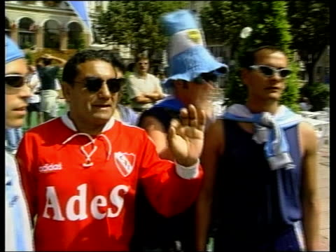 football world cup 1998; j) france: st etienne: ext england fan singing national anthem with gusto argentina fans chanting and dancing england fans... - organisation stock videos & royalty-free footage