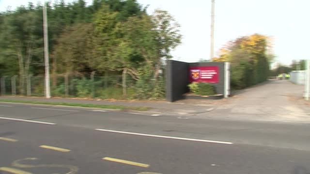 Footballer Andy Carroll escapes gunmen Road outside West Ham training ground PAN entrance 'Romford Road' sign and traffic past