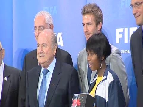 footballer david beckham poses for press alongside fifa president sepp blatter before presenting england's bid to host 2018 world cup zurich; 14 may... - bid stock videos & royalty-free footage