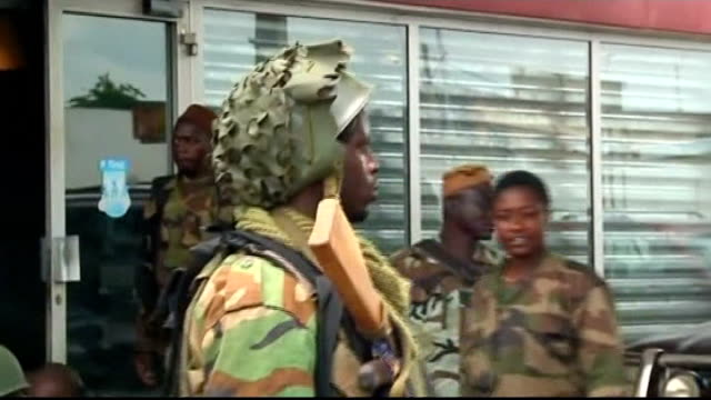 footballer didier drogba to join ivorian truth and reconciliation commission soldiers along street and close shot of patrolling soldier fighters... - côte d'ivoire stock videos & royalty-free footage