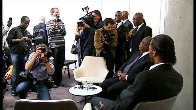 footballer didier drogba to join ivorian truth and reconciliation commission; england: london: int various views of drogba posing for photocall with... - côte d'ivoire stock videos & royalty-free footage