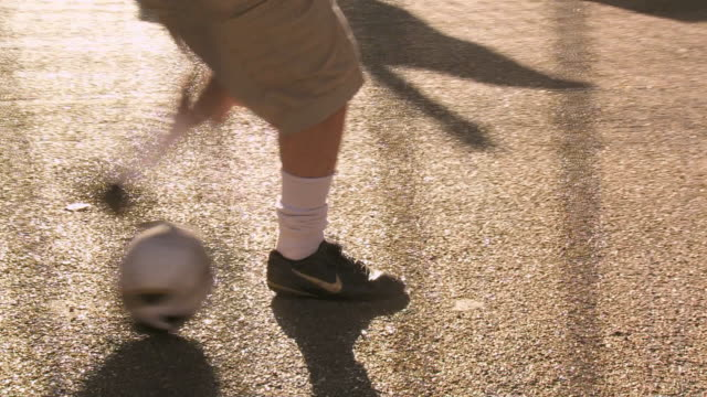 cu ts footballer dribbling, london, uk - warm up exercise stock videos & royalty-free footage