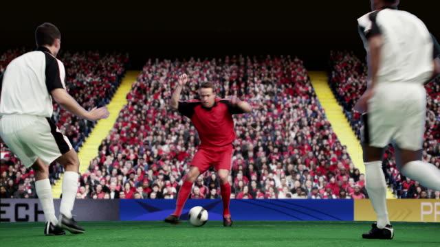 Footballer moving ball past opponents