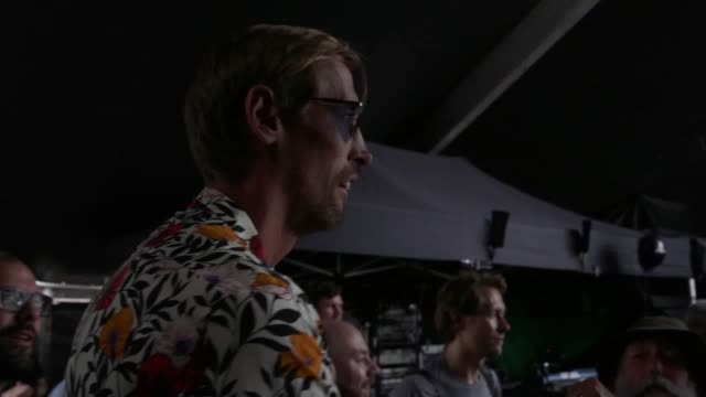 footballer peter crouch and iow festival organiser john giddings surprise festival fans by kicking footballs into the crowd. some were signed by... - お祭り好き点の映像素材/bロール