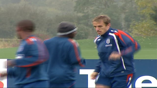 footballer phil neville's daughter wins battle against cerebral palsy; r11100709 england: hertfordshire: ext phil neville during engand training... - sportlerin stock-videos und b-roll-filmmaterial