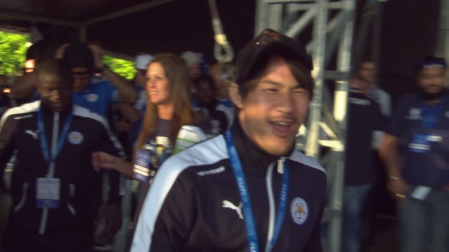 footballer shinji okazaki joins teammates onstage in front of a large crowd as leicester city f.c. celebrates its premier league win in 2016. - only japanese stock videos & royalty-free footage