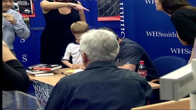 footballer wayne rooney publishes autobiography: book signing and photocall; rooney posing with two copies of his autobiography / rooney sitting for... - autobiography stock videos & royalty-free footage