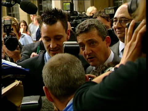 footballers cleared of nightclub attack itn london middlesex guildhall crown court chelsea footballer john terry posing smiling outside court after... - offense sporting position stock videos and b-roll footage