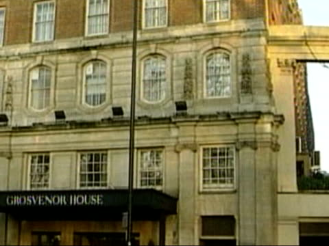 footballers lives; b)itv evening news: geraint vincent lib england: london: ext gvs grosvenor house hotel, where group of premiership footballers... - itv evening news stock-videos und b-roll-filmmaterial