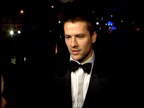 London Gordon Banks arriving at FIFA centenary dinner MSs Two more footballers arriving with partners Michael Owen interview SOT fantastic feeling/...