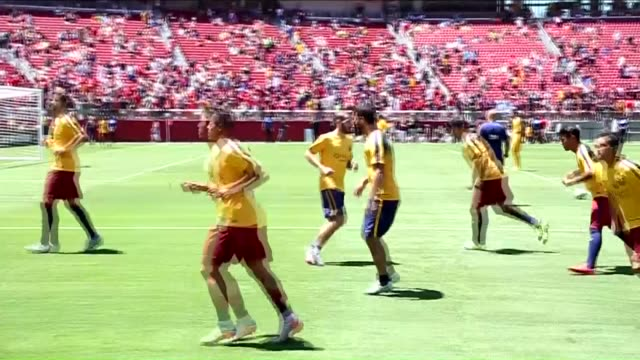 footballers warm up before the 2015 international champions cup match between fc barcelona and manchester united at levi's stadium in santa clara,... - levi's stock videos & royalty-free footage