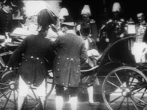 footmen assisting royal personages sitting in carriages / europe / documentary - royalty stock videos & royalty-free footage