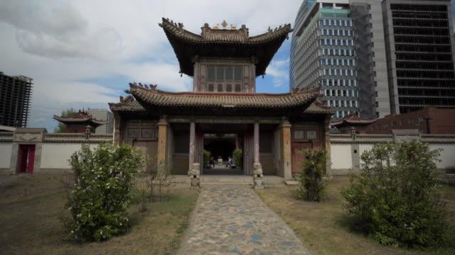footpath leading entrance of choijin lama temple against building in city - ulaanbaatar, mongolia - ulan bator stock videos & royalty-free footage