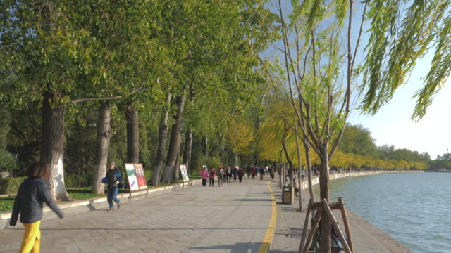 WS Footpath on lakeshore, Summer Palace, UNESCO World Heritage Site, Beijing, China