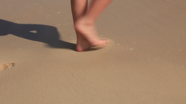 footprint made in sand then washed away by wave - footprint stock videos & royalty-free footage