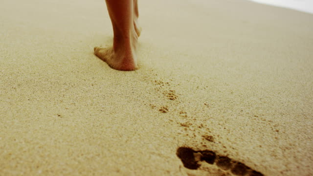 footsteps in the soft sand - footprint stock videos and b-roll footage