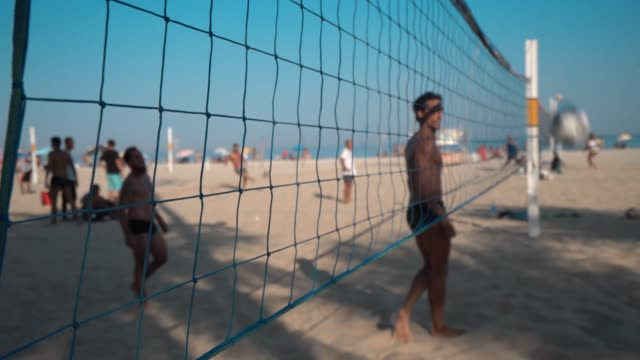 footvolley on beach in rio de janeiro, brazil - volleyball sport stock videos and b-roll footage