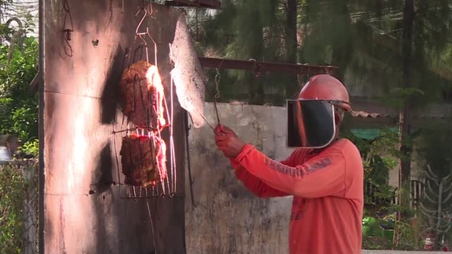 for 20 years thai food vendor sila sutharat has grilled chicken and pork using only the power of the sun using a giant solar reflector he built using... - reflector stock videos & royalty-free footage