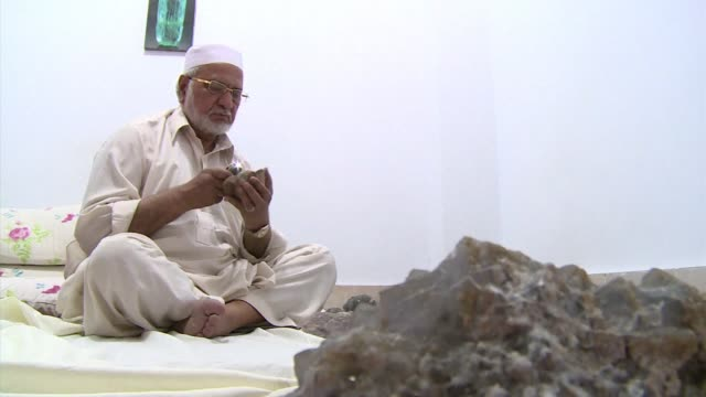 for 400 years the craftsmen and traders of peshawars jewellery bazaar have cut polished set and haggled over precious gems dug from the rugged... - precious gemstone stock videos & royalty-free footage