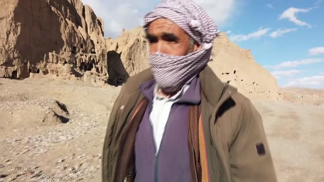 for generations ghulam sakhi and his family, like many others in the bamiyan valley in central afghanistan, took pride in the two giant ancient... - buddha stock videos & royalty-free footage