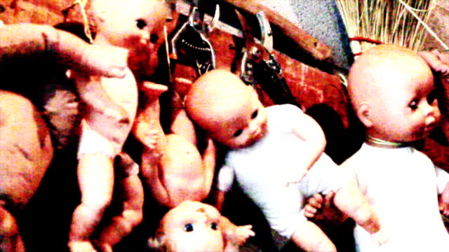 for halloween, haunted dolls hanging in a garage - doll stock videos & royalty-free footage