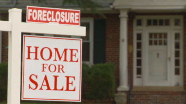 CU, FOCUSING,  'For sale' and 'Foreclosure' signs in front of house, Richmond, Virginia, USA