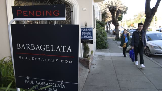 A For Sale sign is seen in front of a home for sale in San Francisco California US on Tuesday Dec 29 2015 Home values in 20 US cities rose at a...
