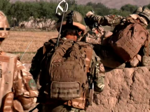 for soldiers fighting in afghanistan, foot patrols are an important part of maintaining security for the local population. but the ever-present... - afghan national army stock videos & royalty-free footage