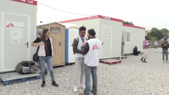 for the cocktail of languages heard on the dirt streets of the calais jungle take a dollop of dari add a pinch of amharic and arabic and sprinkle... - dollop stock videos and b-roll footage